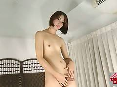Ladyboy Soda lets her hands wander all over her body.