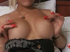 Ladyboy Patty is teasing you with the view of her big boobs.
