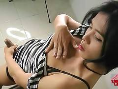 Naughty ladyboy Jeen is sensually caressing herself.