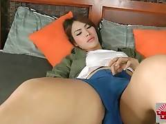 Sexy ladyboy is sensually teasing you through the camera.